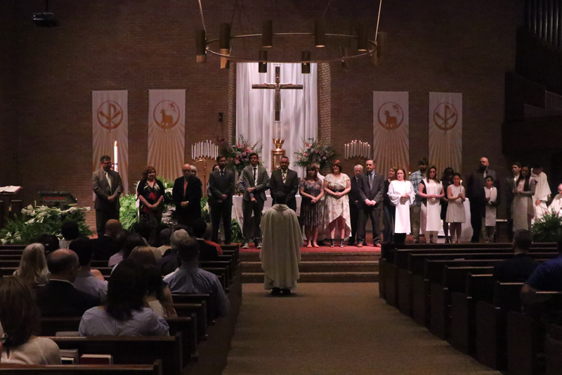 people standing on altar
